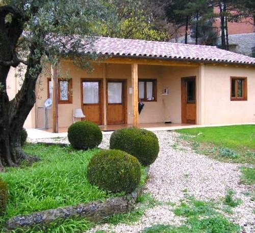 Casa abitabile con struttura in legno e pareti esterne intonacate